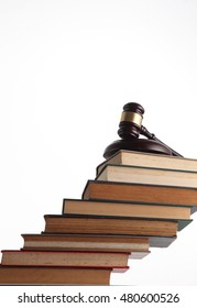 gavel hammer on stack of books