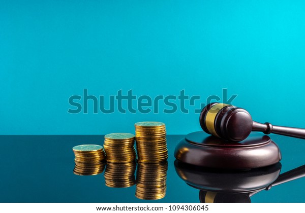 Gavel hammer and stacking coins with financial concept.