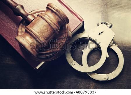 gavel-handcuffs-red-legal-book-450w-4807