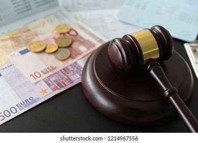 gavel judge with euro money banknote and coin on book bank. banking and finance law.