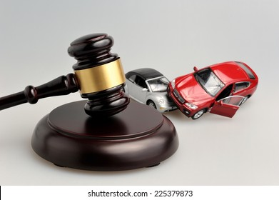 gavel judge with models of car accident on gray background