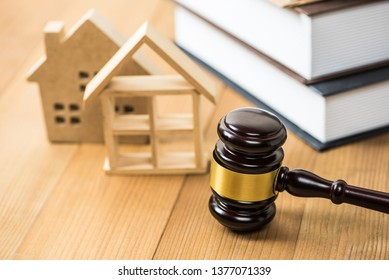 gavel justice hammer and wood house on  wood table background