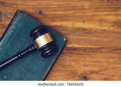 Gavel and law book on a wooden background