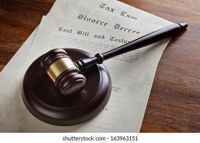 Gavel and legal papers last will and testament, divorce decree and tax law concept for the judicial system
