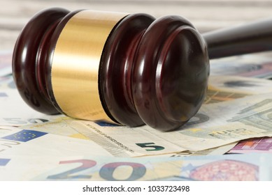 Gavel and many Euro banknotes