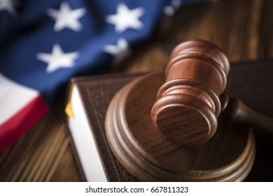 Gavel on bible. American flag on wooden table. Independence day. 4th of july.