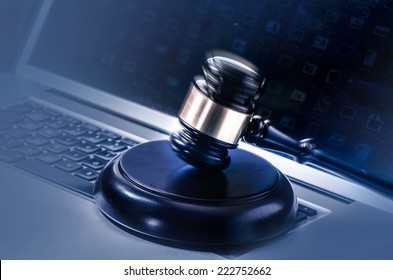 Gavel on Computer - cyber law crime concept image.