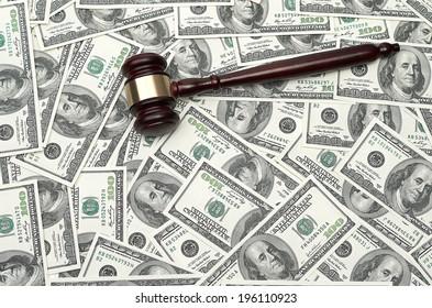 gavel on dollar background