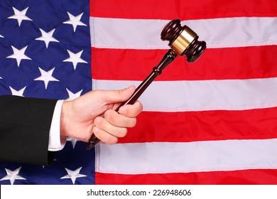 Gavel on Judge Hand over American Flag