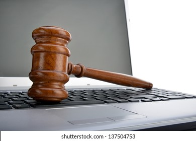 Gavel on a laptop computer isolated on white background