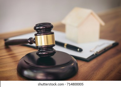Gavel on sounding block at courtroom for decide home insurance, Law and justice concept, Settle a house dealing lawsuit.