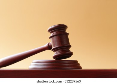 gavel on a stand on a wooden background