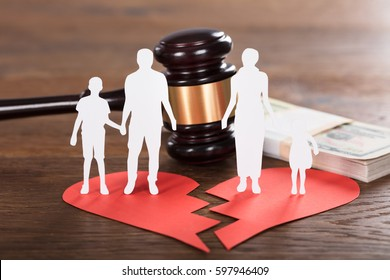 Gavel And Paper Family Representing Divorce On Wooden Desk