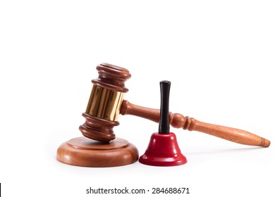 Gavel and red bell with black handle on a white background