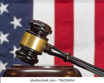 Gavel Rests on Sounding Block with American Flag