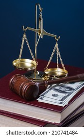 gavel, scale, books and money on blue