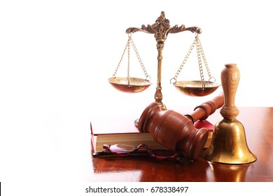 Gavel, scales, bell, glasses and book