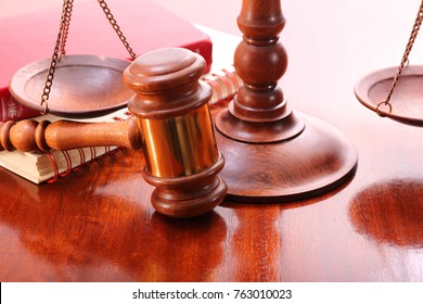 Gavel, scales and book on the table