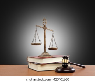 Gavel And Scales Of Justice and Law Books On Desk