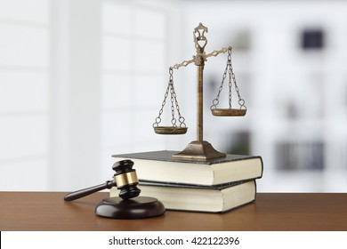 Gavel And Scales Of Justice On Desk In Law Office