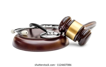 Gavel with stethoscope on stand. Isolated on white. Medical law concept.