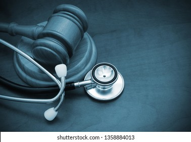Gavel and stethoscope on table with room for text