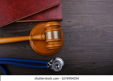 Gavel and stethoscope on wooden background, symbol photo for bungling and medical error. Medicine laws and legal, medical jurisprudence.