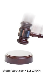 A gavel striking down on a block with motion blur added