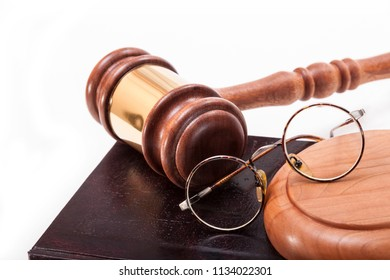 Gavel,glasses and book on a white background
