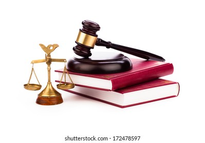 gavel,law book, magnifying glass and scales of justice