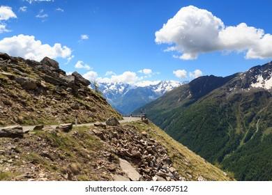 Gavia pass road with panorama view alpine mountains Adamello Alps, Italy