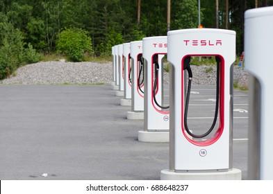 """Gavle, Sweden - July 17 2017. Tesla power charger """"Supercharger"""". Tesla Motors Inc, electric charging station in Gavle bro service-station outside of Gavle alongside the E4 motorway."""