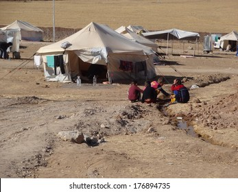 GAWILAH REFUGEE CAMP, BARDARASH, KURDISTAN, IRAQ - 2013 OCTOBER 24 - Syrian children play with water