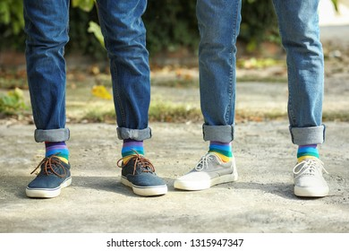 Gay couple with colorful socks outdoors