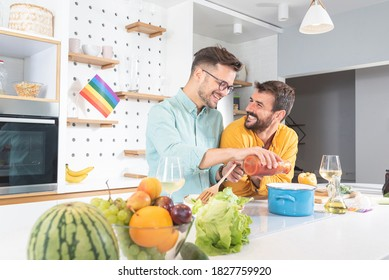 Gay couple cooking food in kitchen