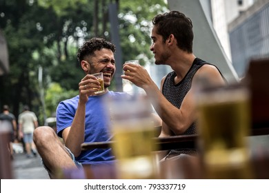 Gay Couple Drinking Beer in Street