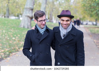 gay couple enjoying a walk in the park