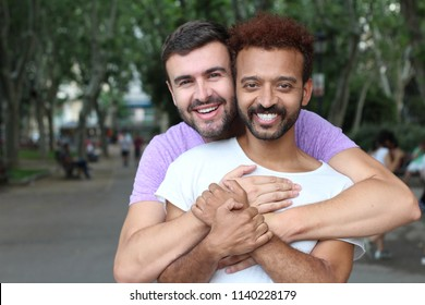 Gay couple holding each other outdoors