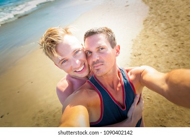 gay couple in love at the beach embracing together,  just married close to the ocean shore at the sea