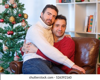 Gay couple of men embracing during christmas time