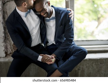 Gay Couple in Navy Blue Tuxedo Sitting Together