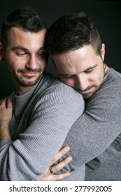 A gay couple on black background studio