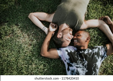 Gay couple relaxing in the grass