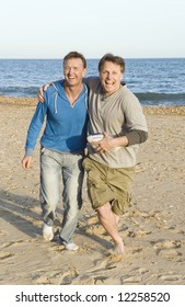 A gay couple running and laughing.