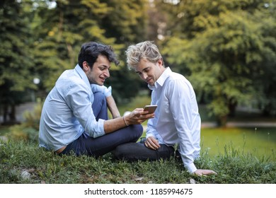 Gay couple sitting in a park.