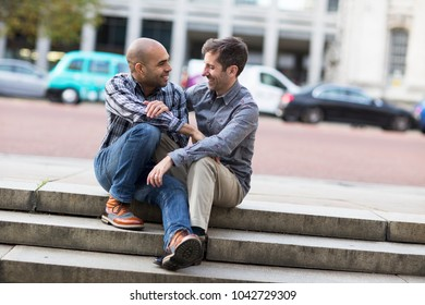 gay couple sitting together