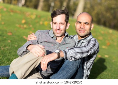 Gay couple sitting together in the park