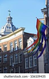Gay flag waving ,  Amsterdam , Netherlands ( Holland )