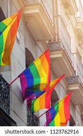 Gay flags waving on balconies in the streets of Madrid during gay pride party and parade
