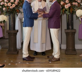 Gay Grooms at Altar on Their Wedding Day